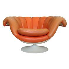 Orange Mid Century Modern Vinyl and Fiberglass Lounge Chair