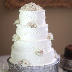 Fresh ivory rosebuds and an elegant scroll design decorated the whipped-cream-frosted cake. Cream Wedding Cakes, Ivory Wedding Cake, Black And White Wedding Cake, Wedding Cake Designs, Wedding Cake Toppers, Wedding Ideas, Wedding Details, Wedding Colors, Wedding Stuff