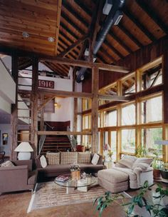 great room in the Sultanik Barn Home in Skippack Pa. blends contemporary with stunning 1800's bank barn timber frame.