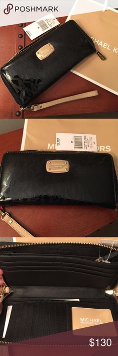 Large Michael Kors signature wallet Brand new with tag ! Black zip around wallet with the signature MK on this beauty ❌no trades MICHAEL Michael Kors Bags Wallets