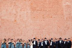 Everyone all together + brick wall + negative space = yes please.