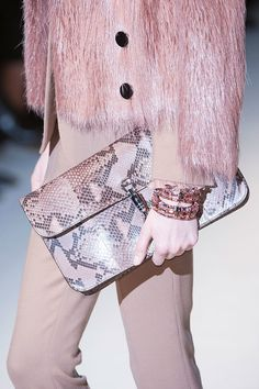 A pop of pink python.  Runway bags at Milan Fashion Week Fall 2014 #MFW