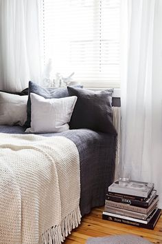 Grey and white bedroom with a splash of cream. Perfect.