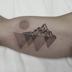 Dotwork mountain range tattoo by Ben Doukakis