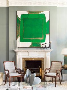 Exquisite fireplace with architectural gravitas, accompanied by abstract art & tortoise shell chairs