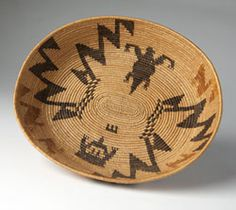 A California Mission Cahuilla polychrome basket :: First quarter 20th century, of shallow oval form with tapering sides over a flat base, decorated with serrated motifs and a lizard, 2.75'' H x 12'' W x 11'' D - est:$2000/3000