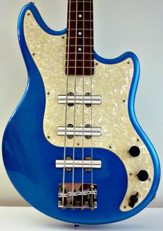 Schecter Hellcat bass in Blue Sparkle, late 90s. The chickenhead knob as a pickup selector and unusual lipstick pickups are retrotastic!