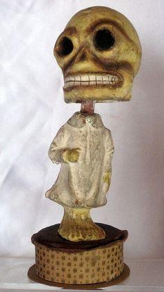 Antique German skeleton nodder/ candy container.