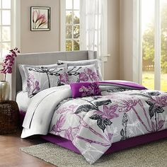 Madison Park Claremont Comforter Set. Make a bold fashion statement in your bedroom with the beautiful Madison Park Claremont Comforter Set. The striking bedding features a large scale bright purple and black floral print on a grey ground.