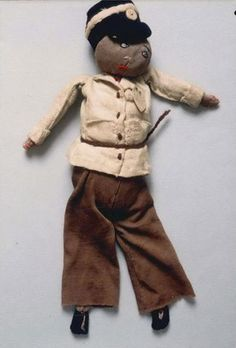 Doll dressed as a policeman, apparently representing Arnold Rubin, a Czech inmate in the Theresienstadt ghetto who was sent from there to Auschwitz and murdered