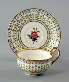 A Nantgarw cup and saucer, 19th century.
