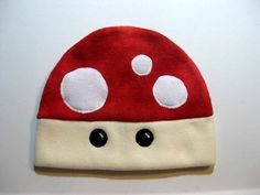 "Title:  MUSHROOM HAT fleece in red. The hat you receive may vary slightly from the one in the photos, due to each hat being handcrafted.      Each hat, measuring approximately 23"" around (average head"