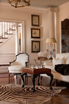Classic tradition mixed with neutrals and funky rug.