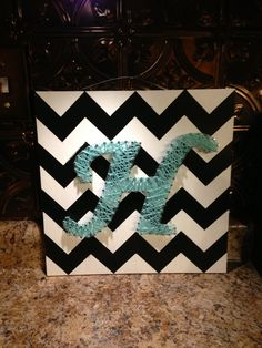 Fabric on wood + string art. Change the monogram to suit your needs!