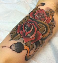 Neotraditional snake and roses by Dannii Garbiras guesting at Black 13; Nashville, TN.