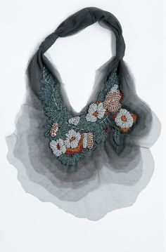 WHO: AKIRA ISOGAWA WHAT: The material used for this neckpiece is silk. WHY: i choose this neckpiece because i use of floral patterns.