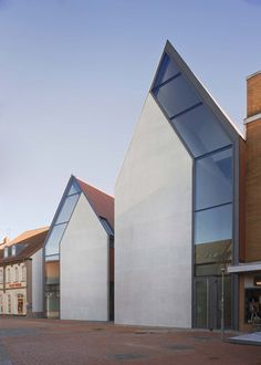 great façade, fun trick to play on our assumption of what the front of a building should look like.