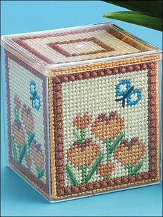 Golden Crocuses Boxes - You'll see how practical a pretty project can be when you stitch these golden-glowing floral boxes! Size: Large Box 4 1/2 inches W x 5 3/8 inches H; Small Box 3 5/8 inches W x 3 3/4 inches HSkill Level: Beginner