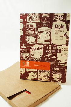 """The cover encompasses the theme of collecting food, a main objective for the foodbank and applies it to the report itself in the form of a grocery bag. The die cut section reads """"shop"""" from the exterior and is realized as """"Shop for others"""" when the cover …"""