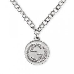 Gucci Silver Coin Necklace     Stock code: 138965 Great for men or women, this necklace is made from silver and features the Gucci logo on a single coin. A lovely gift which will add a designer touch to any outfit.