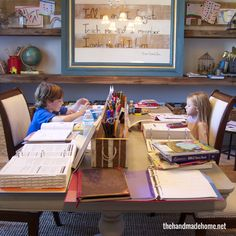 home school room | the handmade home....I love this room and especially the art caddy thing in the middle. Maybe something like that would solve our problem of too much clutter on our dining room table :)