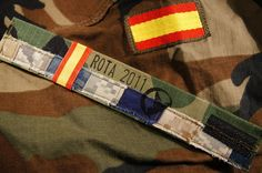 The Rota Spain Bracelet: Designed with American Army, Coast Guard, Air Force, Marine Corps and Navy uniforms, embedded on a Spanish Marine's uniform, donated to Josh Steely, guitarist from the band Daughtry