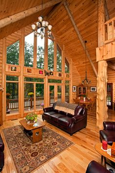 A wall of Pella windows and patio doors welcomes light into this log home. Cabin Design, House Design, Log Home Living, Living Room, Living Spaces, Log Cabin Homes, Log Cabins, Lodge Look, Log Home Interiors