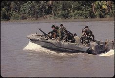 Republic of Vietnam, November 1967: Members of U.S. Navy Seal Team One move down the Bassac River in a Seal Team Assault Boat (STAB) during operations along the river south of Saigon. Description from darkgovernment.com. I searched for this on bing.com/images