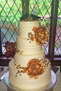 A wedding cake with beautiful golden flowers. Cake # 147.