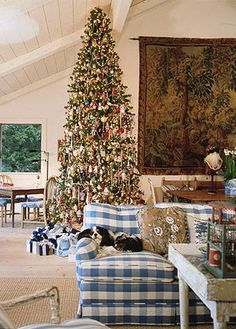 Charles Faudree's Christmas Cabin    Love the tapestry on the wall