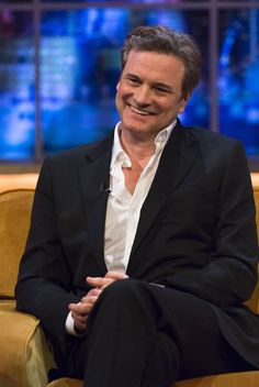 Colin Firth looked dapper in a dark suit for his interview...doesn't he always look dapper? I mean, really?!