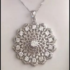 % 925 silver CZ Italian made pendant & necklace Beautiful round, super sparkling AAA,  CZ adorned %925 sterling silver signed & stamped, Italian made pendant approx 1 inch & 18 inch % necklace with lobster clasp also made in Italy. NWT Jewelry Necklaces