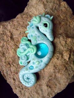 Sea horse from two colours of glamour polymer clay. The eye is a black czech glass bead, the belly glass cabochon. His whole body decorate...