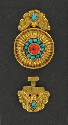 Tibet   Woman's shirt buckle; gold with central portion set with coral and turquoise and side butterfly set with turquoise.   Made for a wealthy woman of Ta-chien-lu   ca. late 19th century   Catalogue No: E131399
