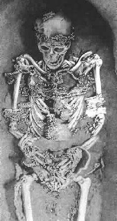 ca. 25,000 years old. Redheaded mummy from Sungir, Russia, Buried dressed with abundant bead work. Found in houses constructed out of mammoth bones and hide. Southern  Russia,.