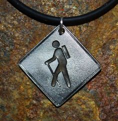 Hiker Pendant by Michael Holland available from the Altitude Gallery consider engraving emergency information on back?