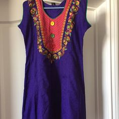"Lightly embroidered blue tunic Beautiful colored light embroidery in front. Size XL Chest 40"" Length 42"" Not a Free People brand but listed as that for more views. Free People Tops Tunics"