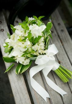 Flowers by Denise Fasanello Flowers  Photo: Tory Williams White Calla Lily and Sweet Pea Bridal Bouquet Brides.com