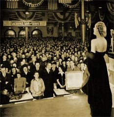 Actress Carole Lombard's last Bond Drive appearance as she leads the crowd in The Star Spangled Banner. Ms. Lombard died the next day in a plane crash while being flown to her next Bond Rally location. Life Magazine Jan 26 1942.