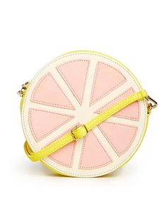 Grapefruit Purse, I think I need it!  This article provides a direct link to the shop.  Yay! ~ Mary Wald's Place - 10 Fruit-Shaped Items That Look Good Enough to Eat