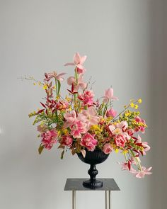 fun and colorful pink and yellow centerpiece with some greenery arranged in a black vessel Flower Arrangement Designs, Beautiful Flower Arrangements, Pretty Flowers, Fresh Flowers, Flower Designs, Design Floral, Deco Floral, Arte Floral, Ikebana