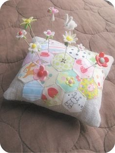 Will have to try to make one of these hexie pincushions