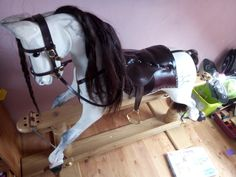 Hand made dappled rocking horse on oak stand with leather saddle and real horse hair tail.