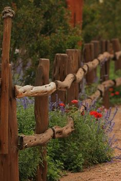 a very cool garden fence made from branches