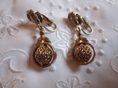 Vintage Gold Tone Victorian Style Clip On Earrings with Fancy Stud and Dangling Circle with Textured Bead and Leaves