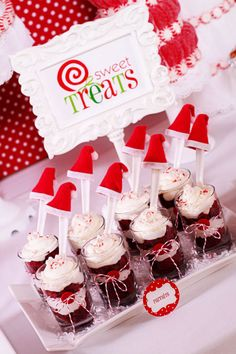 Red velvet parfaits served with a Santa hat topping the spoons, holiday party idea (Dessert Shooters Red Velvet) Christmas Sweets, Christmas Cooking, Christmas Goodies, Christmas Candy, Christmas Desserts, Holiday Treats, Holiday Parties, Holiday Recipes, Christmas Ideas