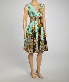 Love this Aqua & Black Floral Pleated Surplice Dress - Women on #zulily! #zulilyfinds