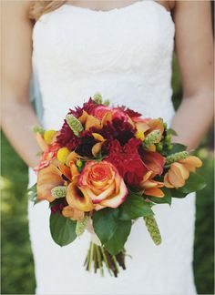 red and orange wedding bouquet - love the fall colors. The only change I'd make would to have less greenery and more champagne colored flowers