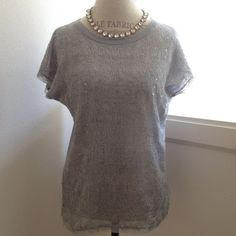 Urban Outfitters Top I don't even know how to describe this very pretty top.  The front part is a made out of a lacey (but not really lace) material with scattered sequins and the back is just your regular heathered gray tee.  Unfinished neck, sleeves, and hem lines just add to the uniqueness of this top.  Worn once, in excellent condition. Urban Outfitters Tops