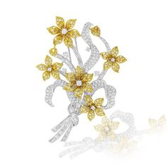 Frangipani Inspired Brooch made with White and Fancy Yellow Diamonds set in…